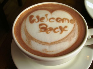 A cappuccino with the words 'Welcome Back' in the foam.